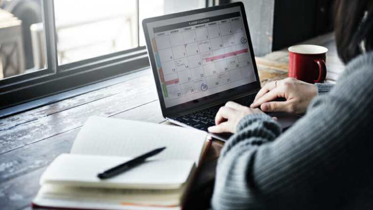 Typing on Computer in Calendar Creating an Ideal Week