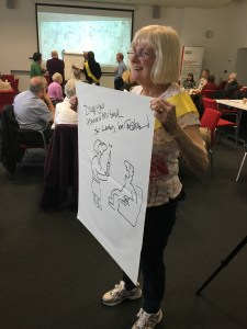 Lesley Calvert, former district nurse from Salford with her personalised nurse cartoon by Tony Husband