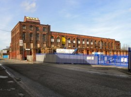 GMP are investigating an attempted murder following a shooting outside Kingston Mill in Salford