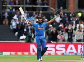 India's Rohit Sharma celebrates reaching his century during the ICC Cricket World Cup group stage match at Emirates Old Trafford, Manchester.