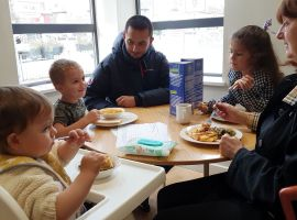 A family enjoying their free meal at Langworthy Cornerstone. Photo by: Ellie Kemp.