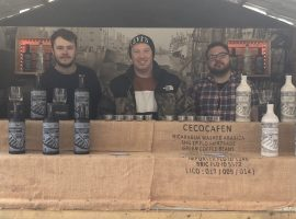 James Harrison (middle) of The Salford Rum Company at the Manchester Christmas Markets. Credit: Caleb Staples