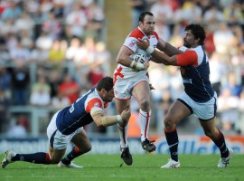 England's Adrian Morley is tackled by France's David Ferriol (left) and Michael Simon during the international match at Leigh Sports Village, Manchester. Credit: PA Images