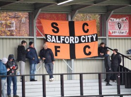 TANGERINE AND BLACK: Kedzior bringe his tangerine and black flag as a reminder that Salford City was a football club before the Class of 92 takeover in 2014.