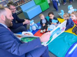 Salford's City Mayor Paul Dennett with kids at a storytime session at Swinton Library (Photo courtesy of Nick Harrison for Salford Leisure)