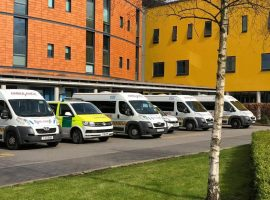 Ambulances line up at Salford Royal ready to take people home. Image credit: Holly Pritchard