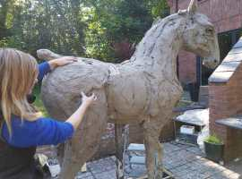 Emma Rodgers creating sculpture.  Copyright image: Emma Rodgers
