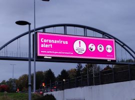 Salford overpass, coronavirus warning. Image credit: Matthew Lanceley