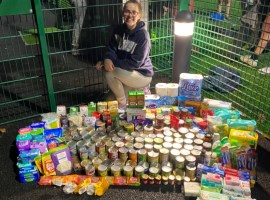 Picture of Cerys Eccleston with the food donations