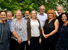Picture of some of the staff and directors across the 8 GM Credit Unions (Salford CEO on far left) Image Credit: Salford Credit Union