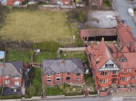 Council defers Bolton bowling green house application