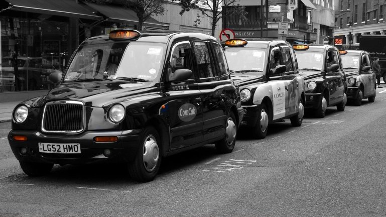 Black taxis in Salford, who will be facing the new taxi driver's dress code. Photo credit: Tommes64 https://pixabay.com/photos/london-covent-garden-taxi-england-2878425/