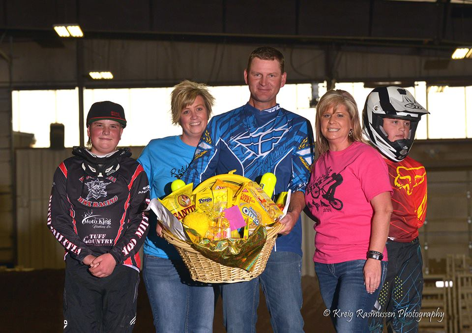 Roger and Michelle receiving a gift basket from thankful BMX parents.