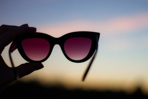 glasses held up to sunset