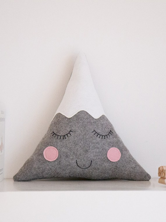 mountain_cushion_with_face_on_bookshelf