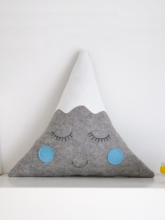 mountain_cushion_with_face_on_bookshelf_blue