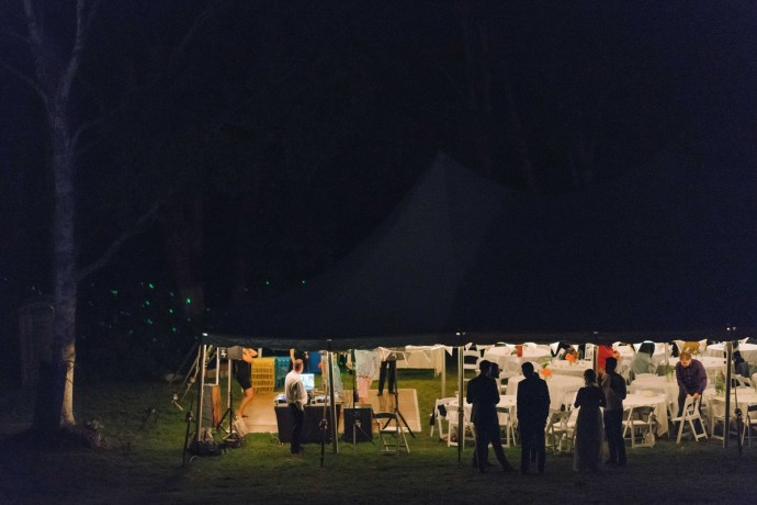 Nighttime outdoor wedding reception in tent at 1774 Inn