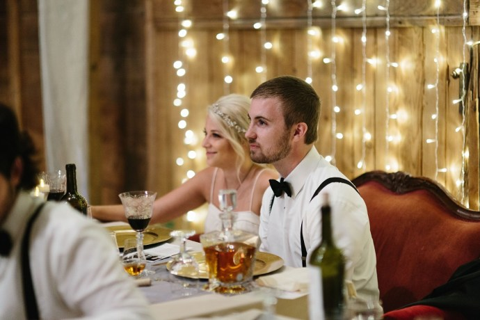 Bride and groom at head table with cute lights in background