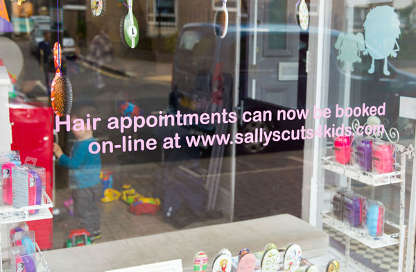 Childrens hairdressing salon window signage