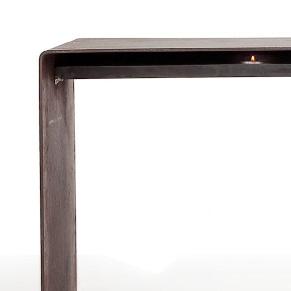 Raumgestalt Wärmebank aus Stahl mit Teelichten