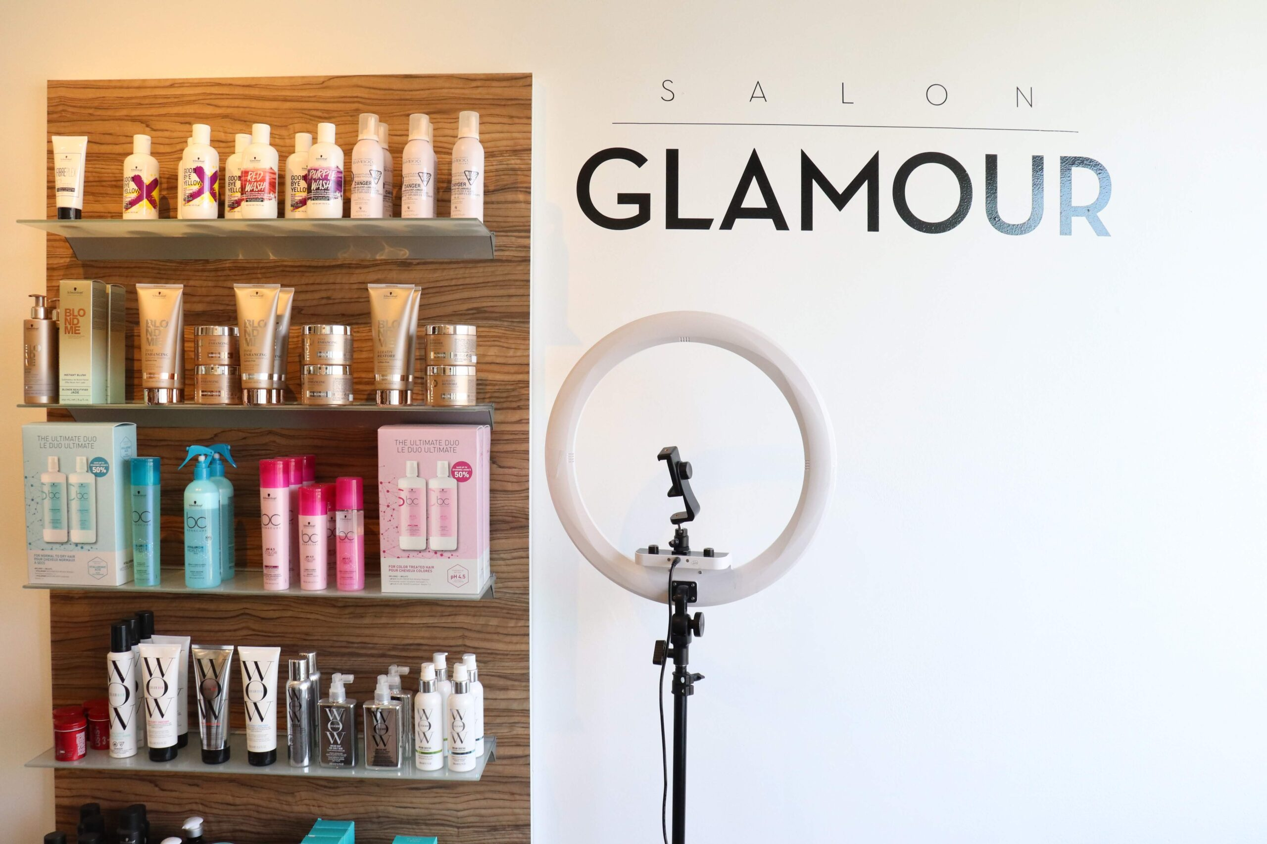 luxury hair care products sit on display shelves in Salon Glamour's Etobicoke salon location