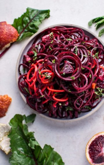 This spiralized raw beet salad with blood oranges is a refreshing vegan salad that takes advantage of vitamin-packed winter produce, is easy to make, and looks beautiful!