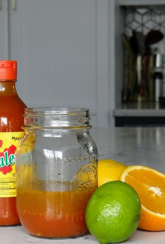 Jar of my Spicy Citrus Dressing and some of the ingredients I used
