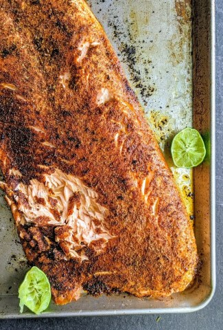 Sheet pan with Blackened Salmon with limes