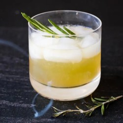 Image of a smoky cocktail featuring Rye whiskey and rosemary