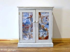 decorative door panels in painted cabinet