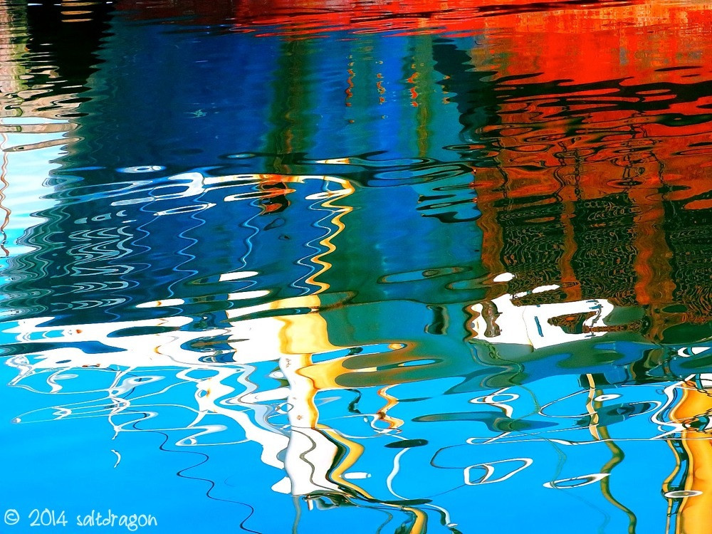 Reflections of a fishing boat