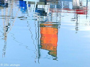 Orange sail at Newlyn