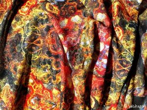 "scarf fabric featuring ""embroidered rust"" design"