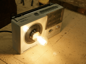 Radio upcycled into a lamp