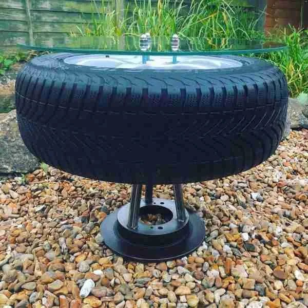 Car wheel coffee table with toughened glass top by the salvage sister