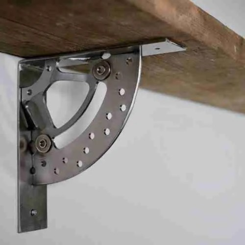 industrial style shelf bracket made from motorbike break disks