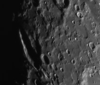 Schiller is a very oblong lunar crater. It seems to be a fusion of two or more craters, probably created by a very oblique impact.