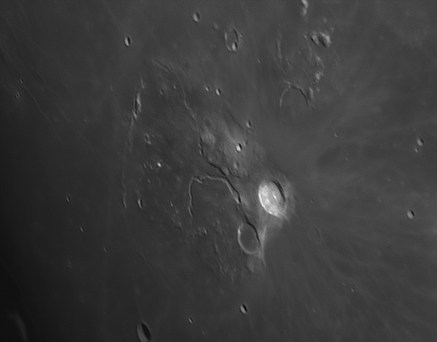 Aristarchus is a young, and therefore very bright crater. Next to it is the Schroeter Valley, a rille, probably created by flowing lava.