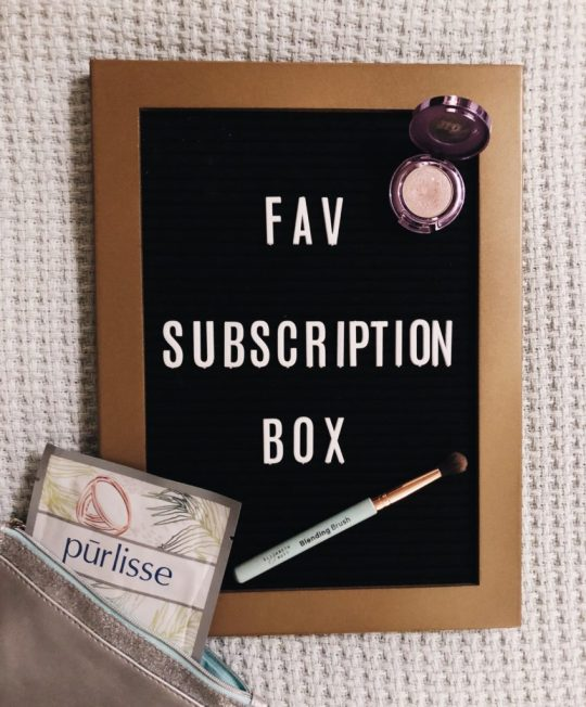 "Letter board with, ""fav subscription box"" on it"