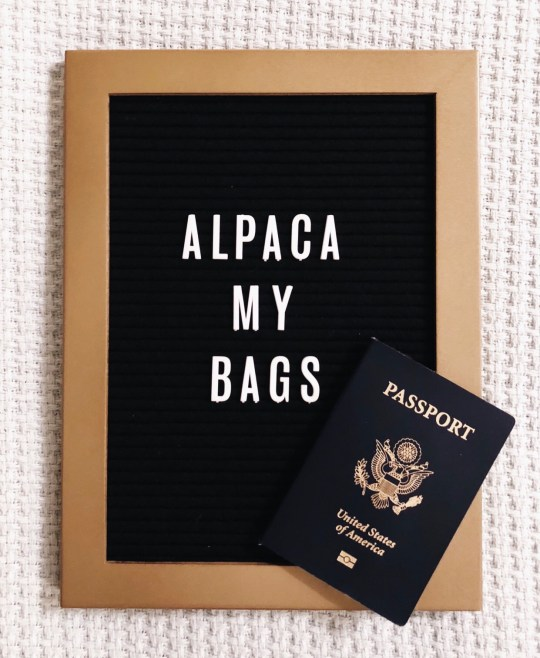 "Letter board with ""Alpaca My Bags"" and passport - travel 2018"