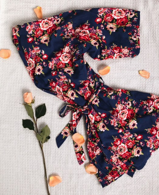 Floral robe flat lay with roses