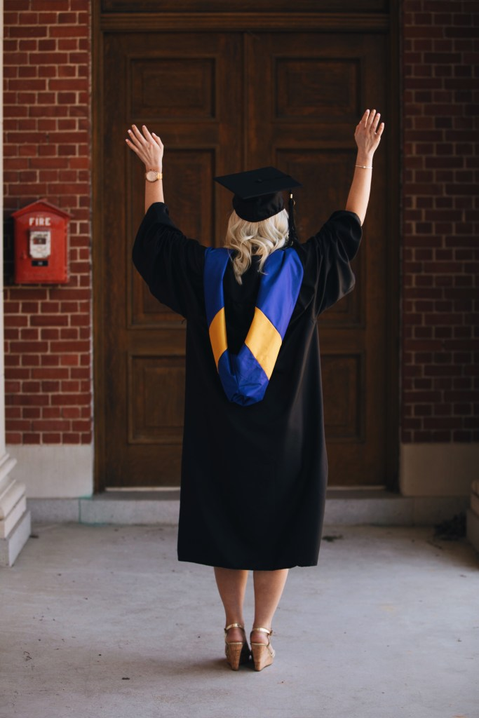 Samantha Marie Blog | graduate with hands in the air wearing cap and gown