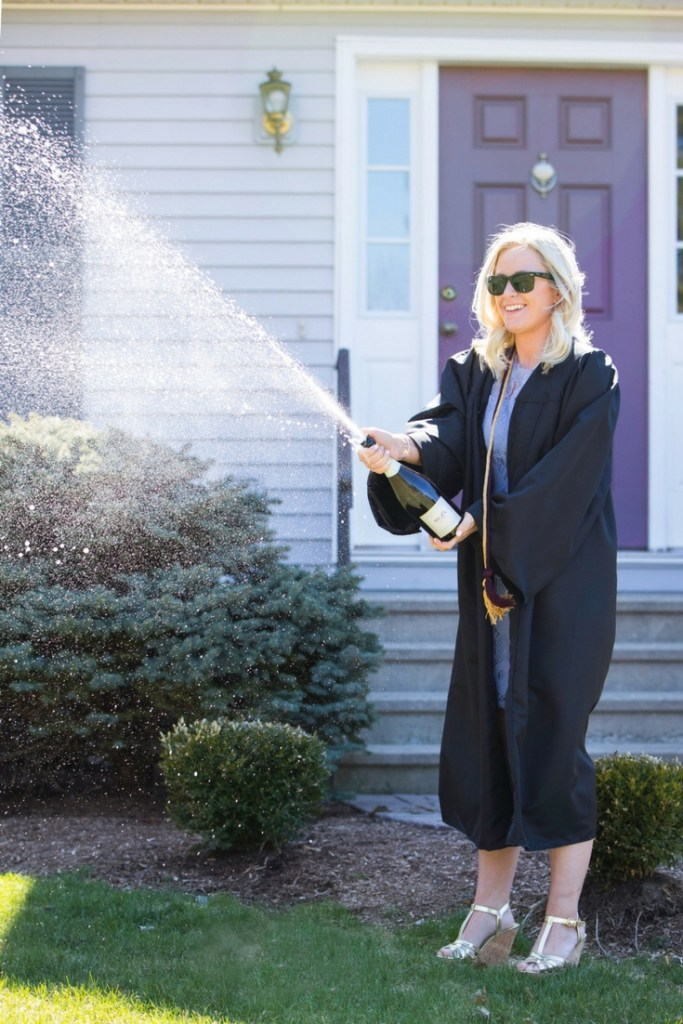 Samantha Marie Blog | Graduation shoot, opening bottle of champagne in cap and gown