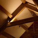 Lounge lighting with wooden beams by Sam Coles Lighting 07