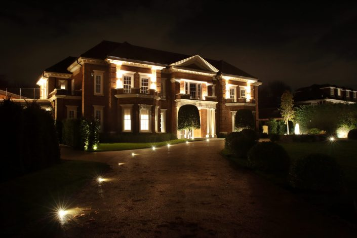 House front and illuminated driveway