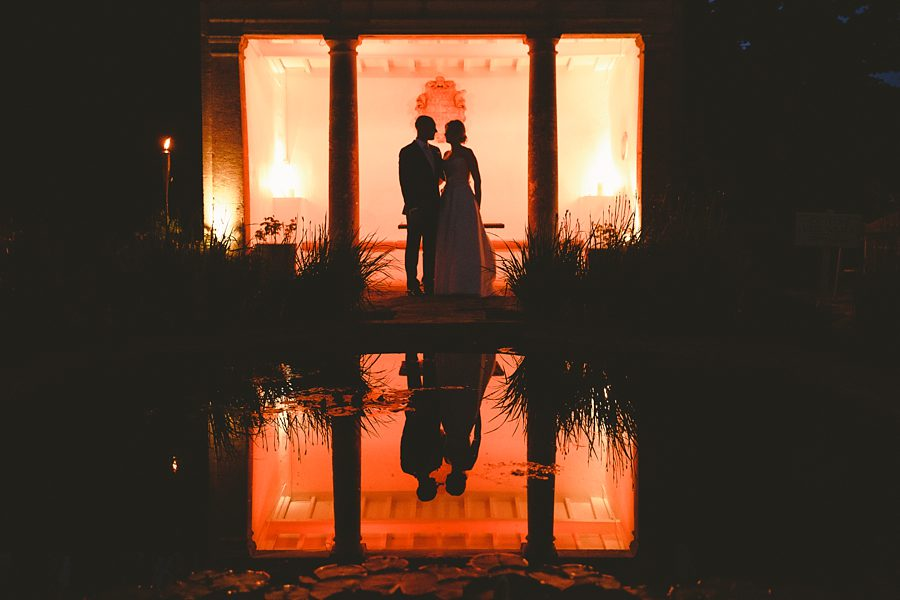 bride and groom portrait at night at barnsley house by sam gibson