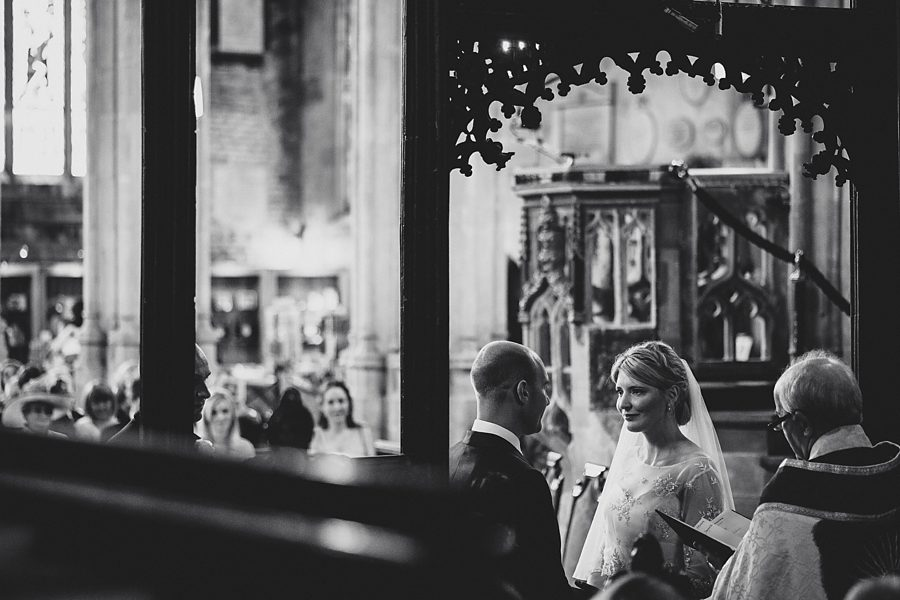 bride and groom at cirencester church by sam gibson