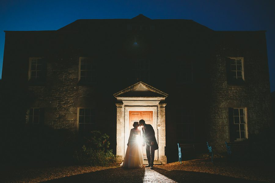 bride and groom portrait at night at a tetbury wedding