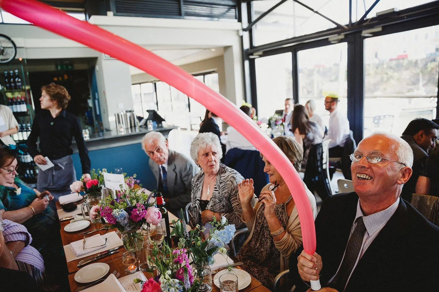 man with rubber balloon at a wedding