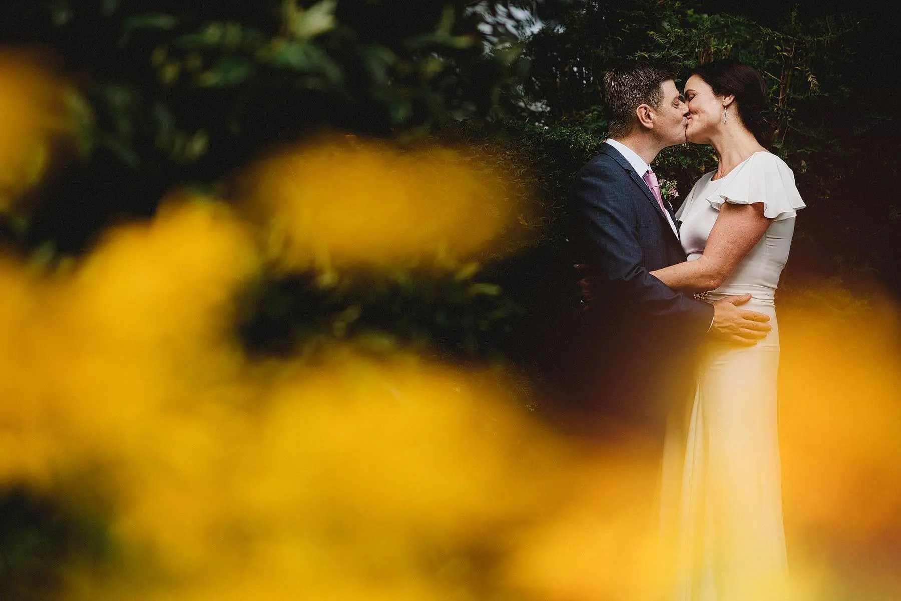bride and groom kiss barnsley house cotswolds